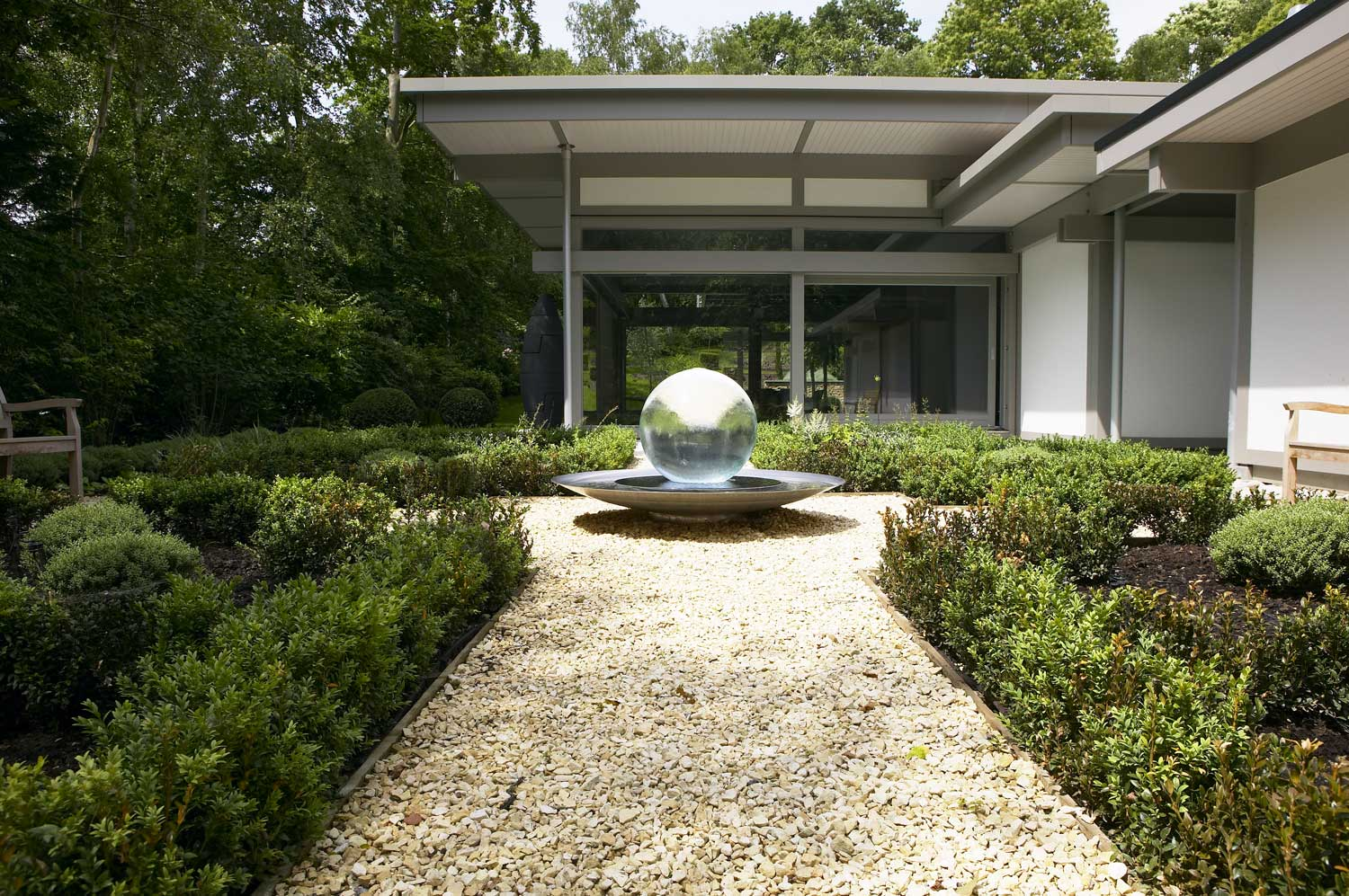 Twin wing Huf Haus with linking hallway and garden rill | Residential Photographers London