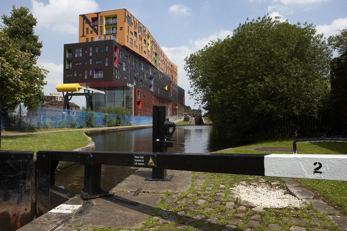 Chips in New Islington, Manchester by Will Alsop, is a mixed use development surrounded on three sides by canals. | Construction Photographer