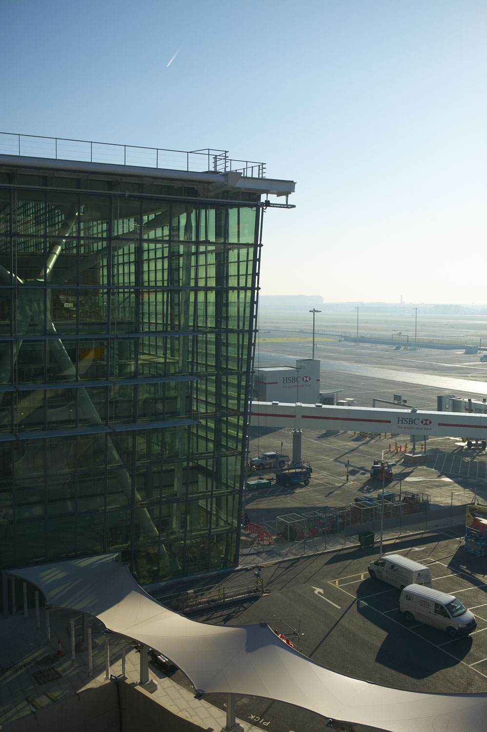 Heathrow Airport Terminal 5 glazed facade and apron at dawn | Architectural Photographer