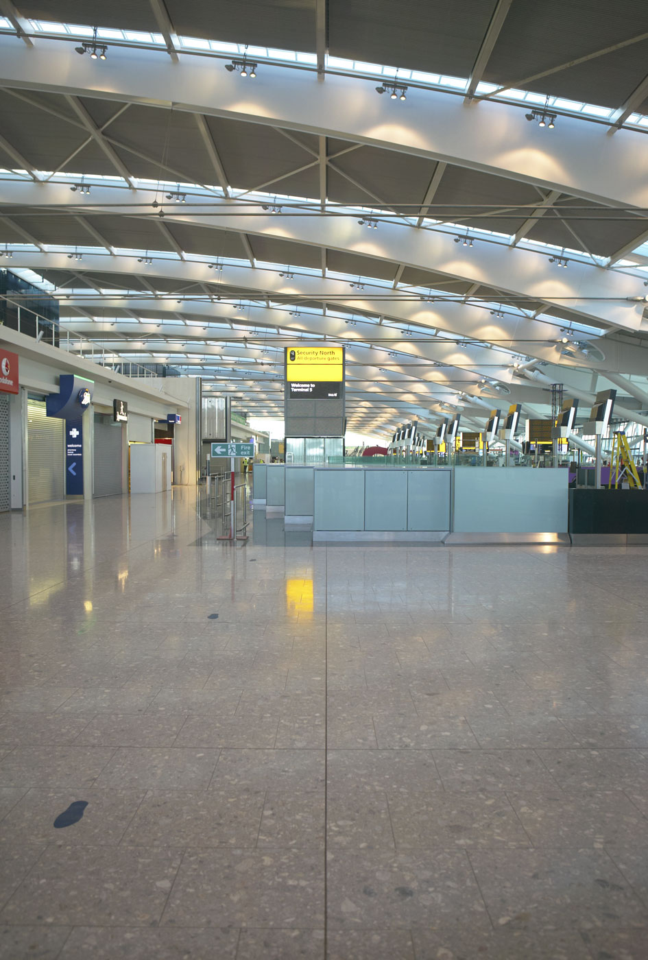 Heathrow Airport Terminal 5 steel and glass arched roof | Commercial Photographers London
