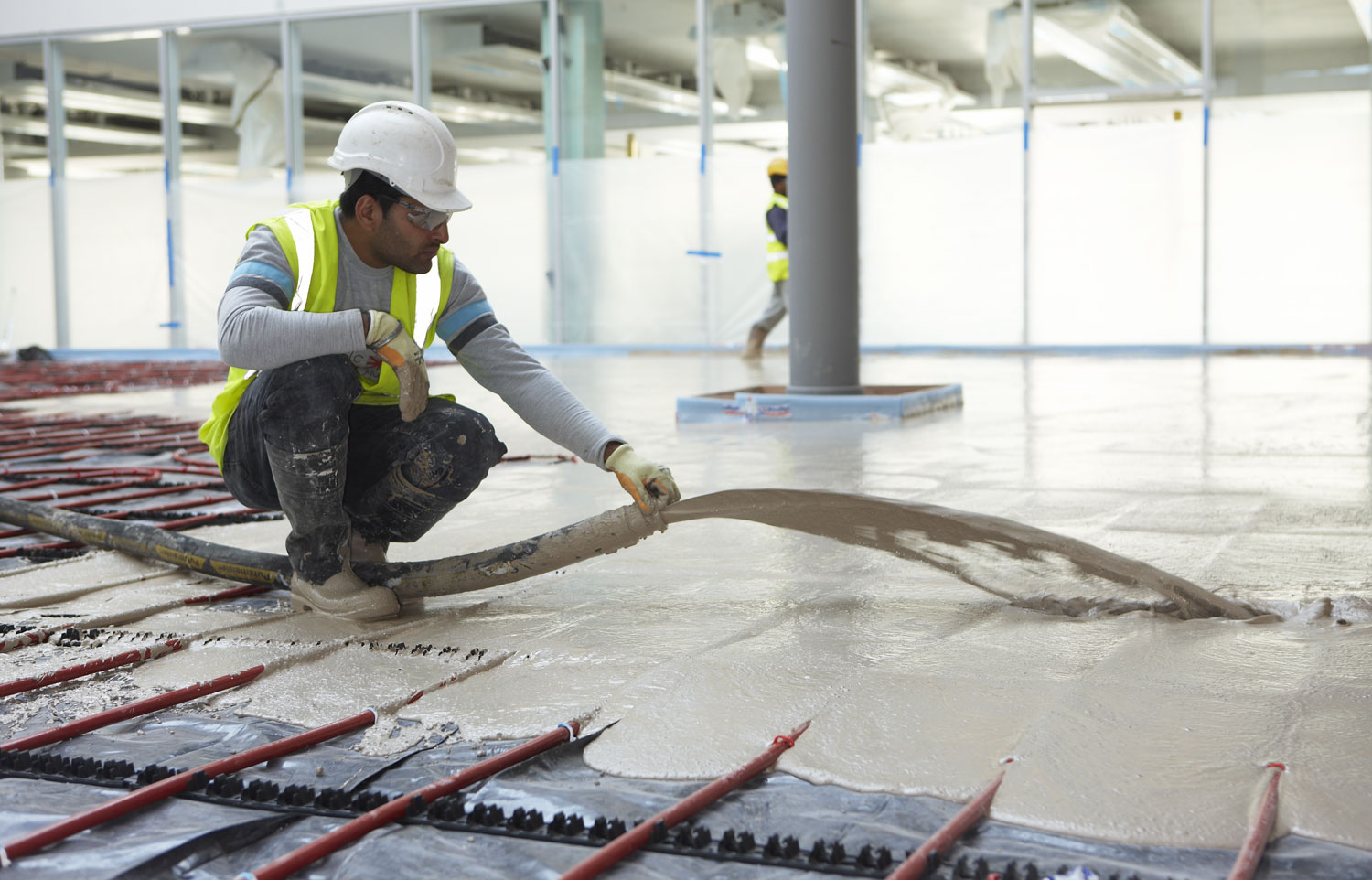 Atkins headquarters atrium underfloor heating system and pumped wet screed | Architectural Installation Photography