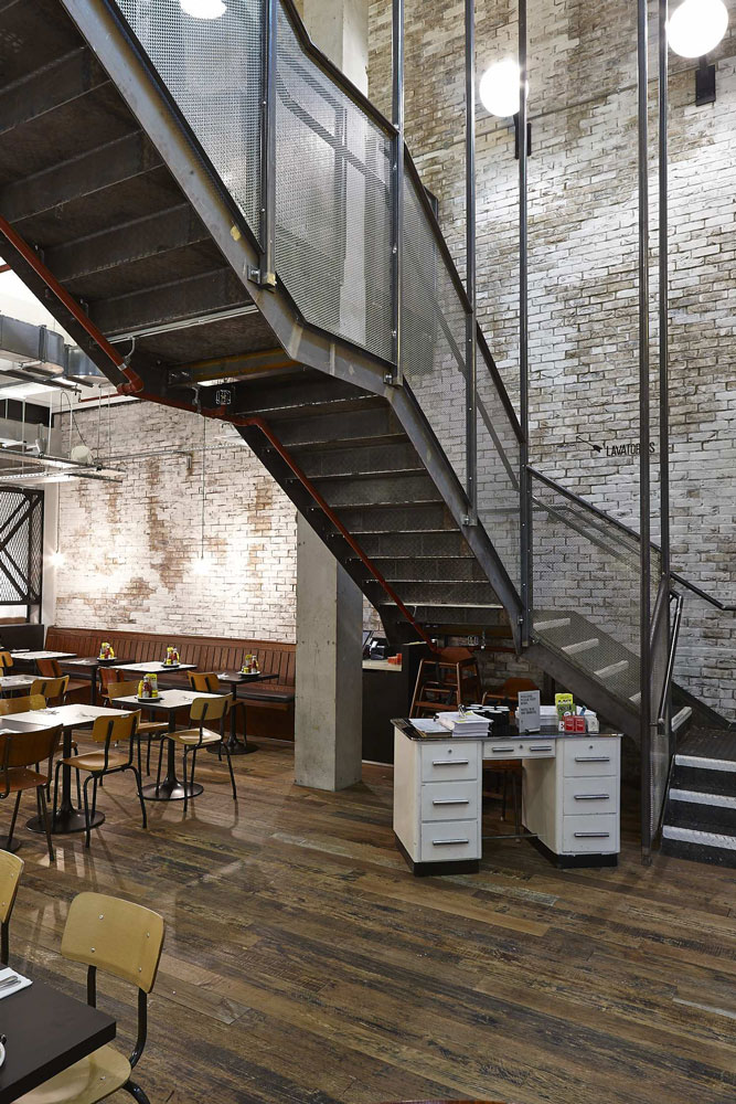 Byron Proper Hamburgers steel staircase at the O2 Arena, Peninsula Square, London | London Restaurant Photography | Commercial Interiors Photographer